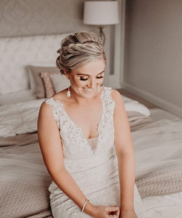 Real bride wears a lace detailed Enzoani wedding gown