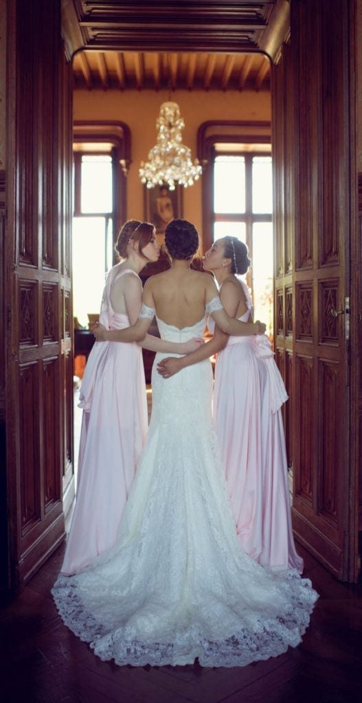 white lily couture bride and bridesmaids kiss