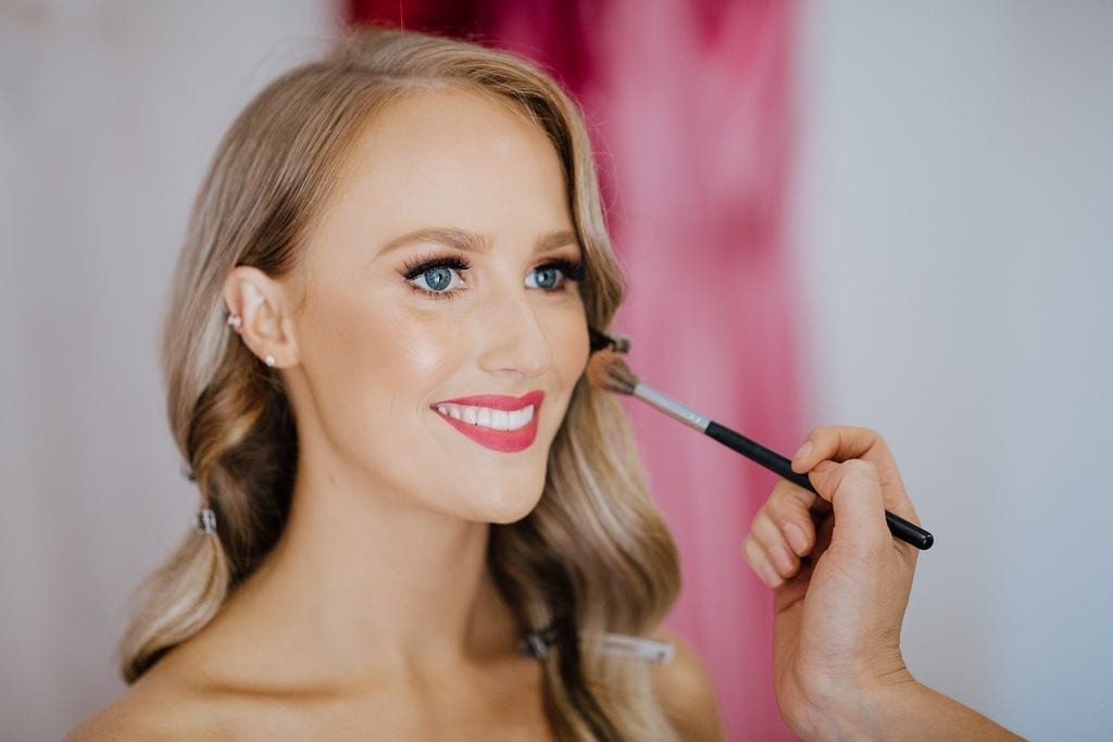 Bride Zoe getting glammed by KM Makeup Studios and Petula Jade Hair Stylist