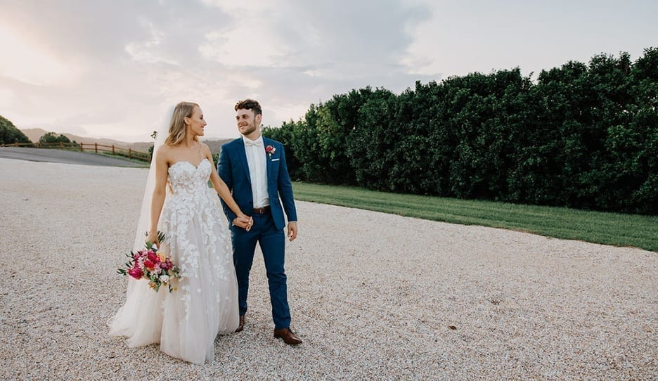 Mori Lee wedding dress with pink bouquet couple photo